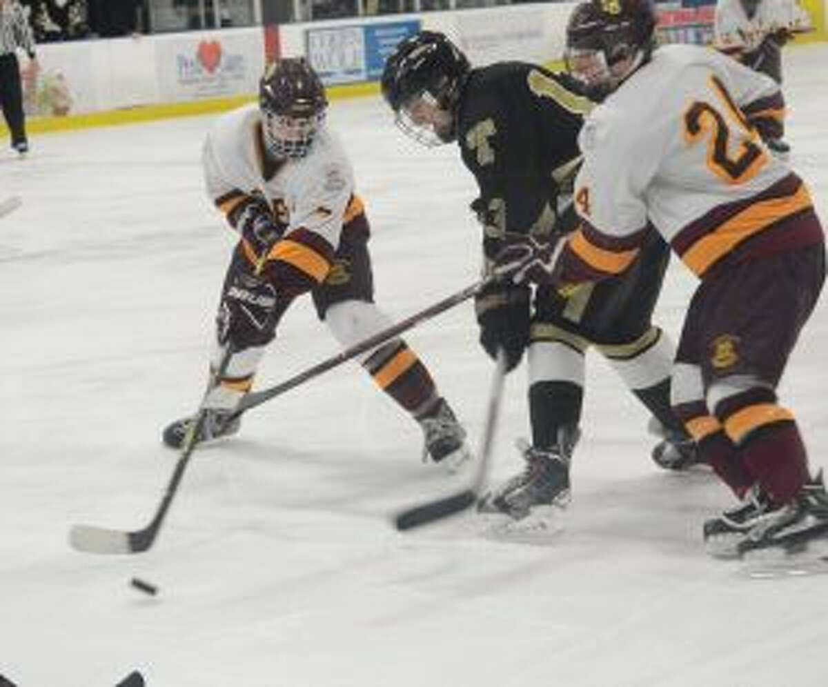 Sam Bracchi looks to take control of the puck.