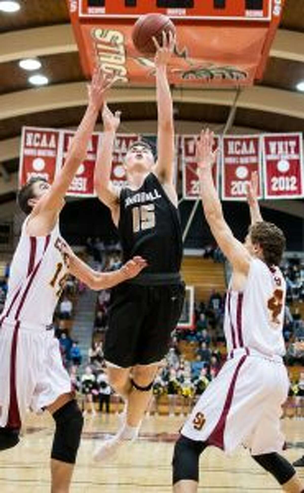 Trumbull High's Chris Brown gets to the basket for two of his 24 points on the night. - David G. Whitham photos