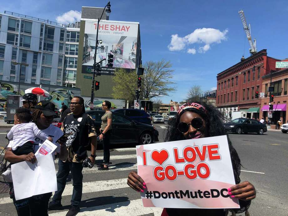 Supporters at a rally April 10 celebrate the music coming back to Central Communications, a Metro PCS vendor on the corner of Seventh Street and Florida Avenue NW in Washington, D.C. Photo: Washington Post Photo By Marissa Lang / The Washington Post