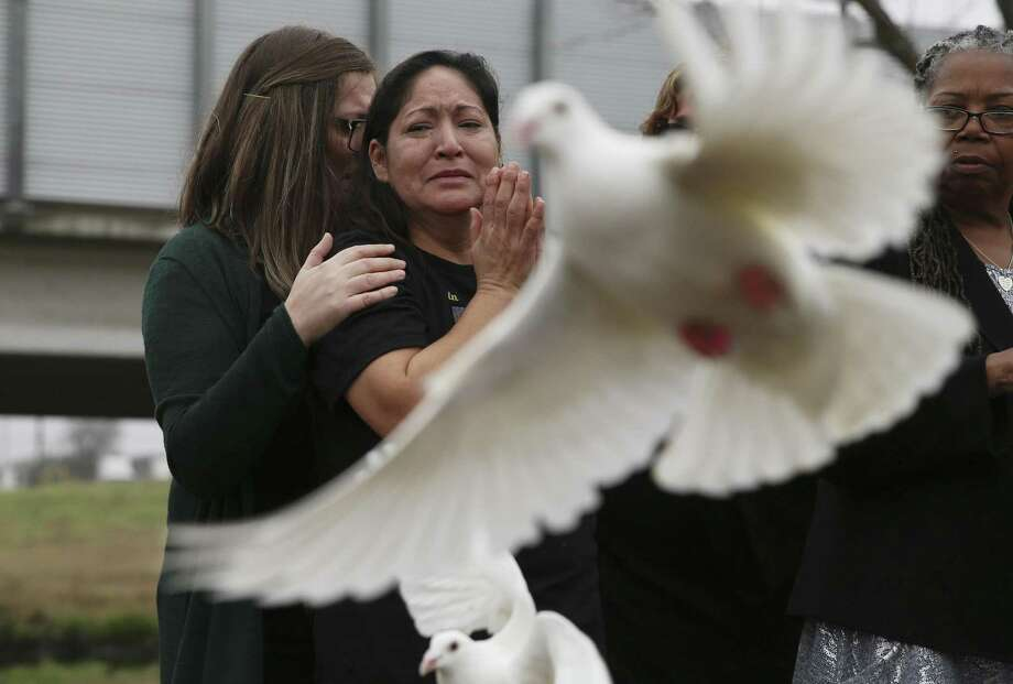 The maternal grandmother of baby King Jay Davila watches with sorrow as doves are released during a Feb. 2 ceremony to remember her 8-month-old grandchild. Photo: Kin Man Hui / ©2019 San Antonio Express-News