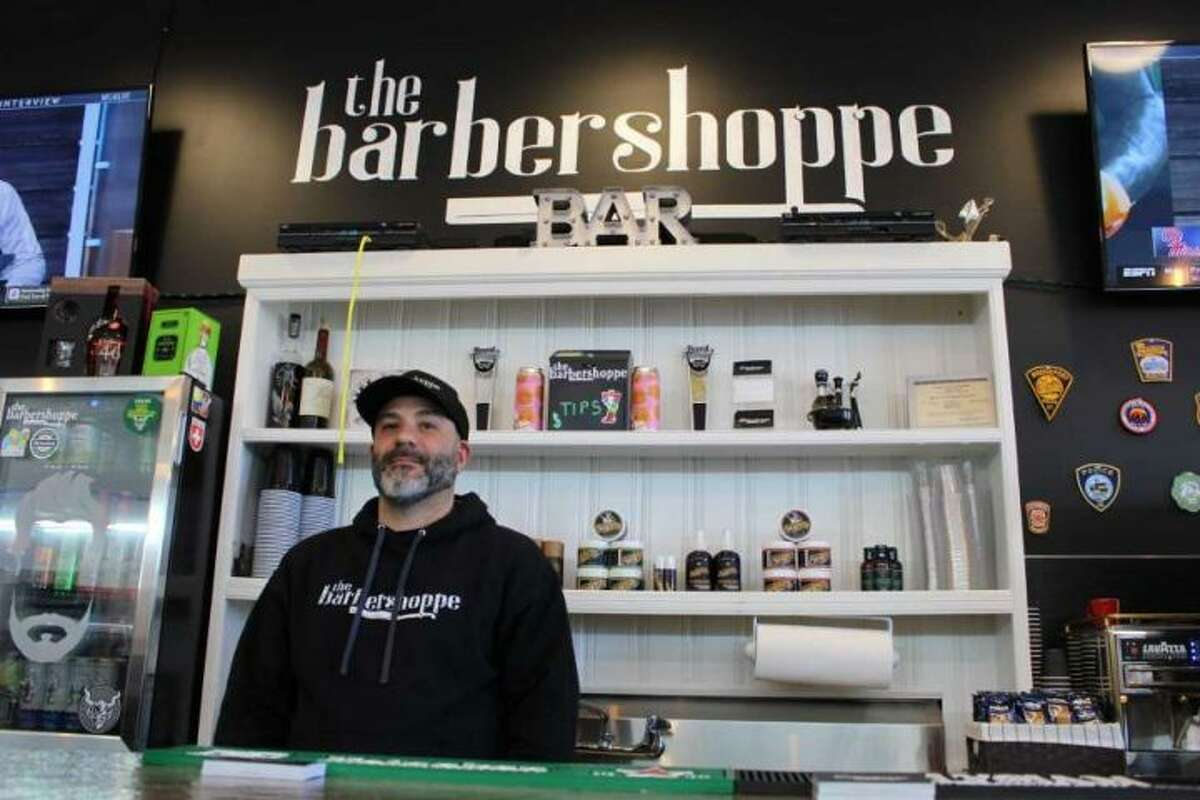"""Ralph Bonadio, owner of the Barbershoppe in Trumbull. The new business offers a variety of services, including """"regular"""" haircuts and hot-towel shaves. - Jordan Grice"""