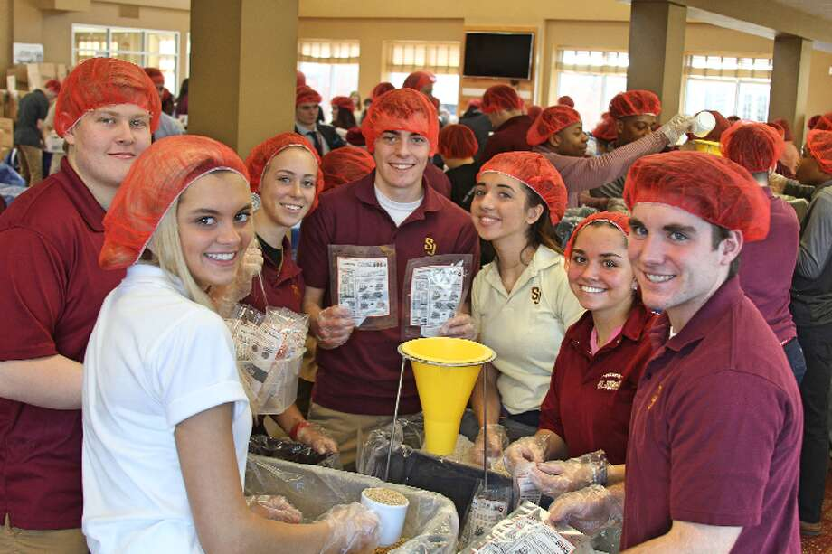 St. Joseph students recently celebrated the feast day of the school's patron saint by packing 24,000 meals for people living in the African nation of Burkina Faso.