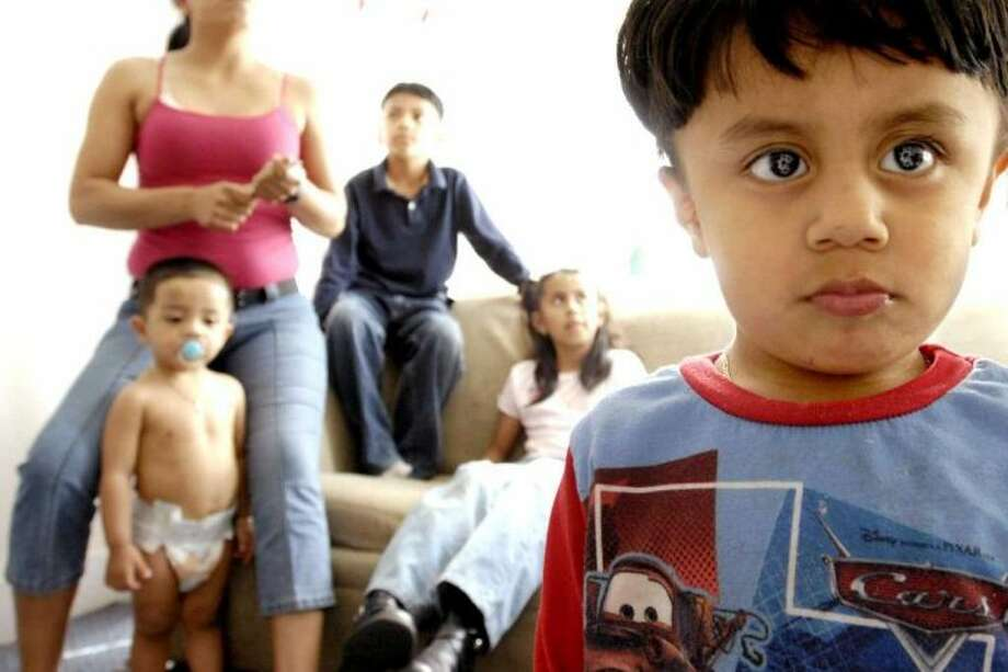 n a file photo, children of undocumented immigrants from Mexico are shown in their New Haven home. The American Civil Liberties Union on Wednesday issued a report indicating that police in several Connecticut towns have cooperated with immigration officials; monitoring the location of undocumented individuals.