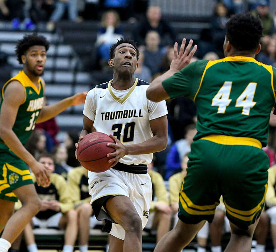 Timmond Williams scored 28 points as Trumbull beat Hamden 76-61 Wednesday at the Floyd Little Athletic Center in New Haven. The fifth-seeded Eagles face No. 4 Sacred Heart Monday at 7 at Pomperaug High School in Southbury. — David G. Whitham Photo