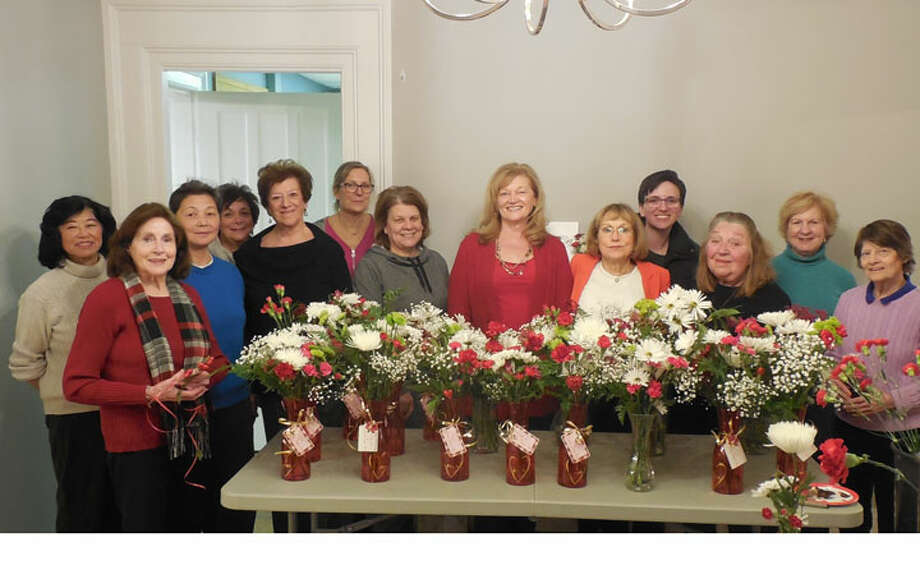 Nichols Garden Club members pose with a sample of their Valentine's Day floral arrangements.
