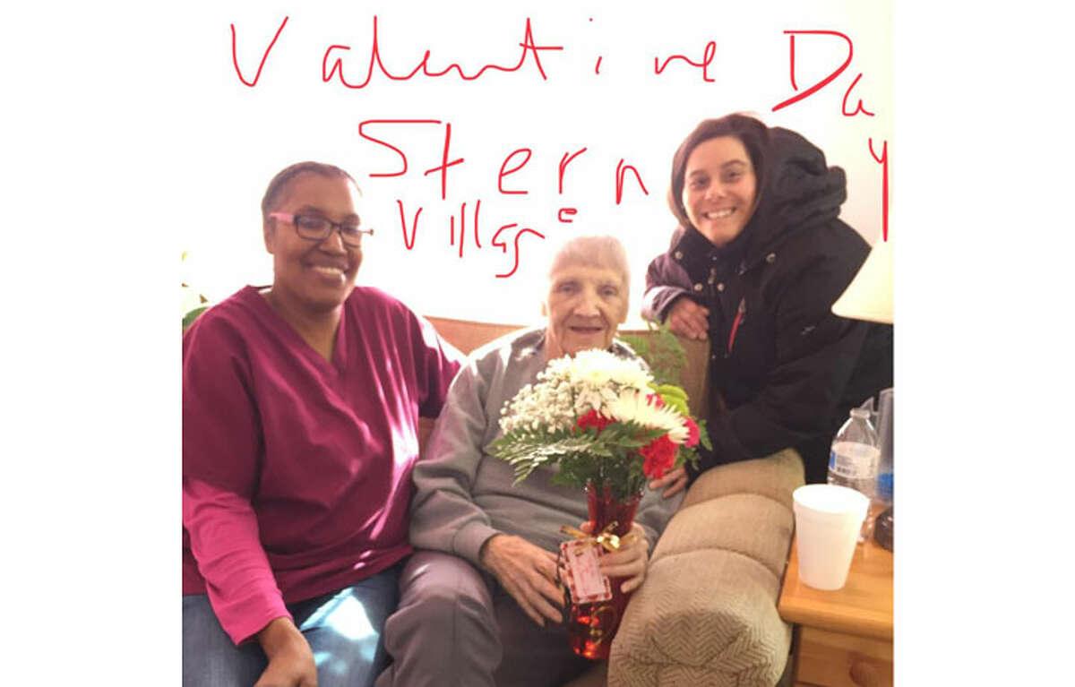 A Stern Village resident enjoys her Valentine's Day flower arrangement
