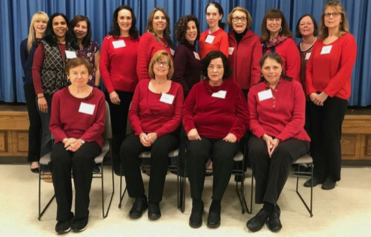 Trumbull Community Women showed its support for the American Heart Association's Go Red For Women Campaign by wearing red at their February meeting. The group also distributed Red Dress pins at both Trumbull libraries.