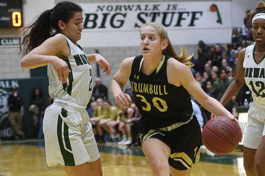 Trumbull's Allison Palmieri drives to the hoop while Norwalk's Ashley Wilson defends during the regular season meeting between the league's top two seeds. — Brian A. Pounds/Hearst Connecticut Media photo / Connecticut Post