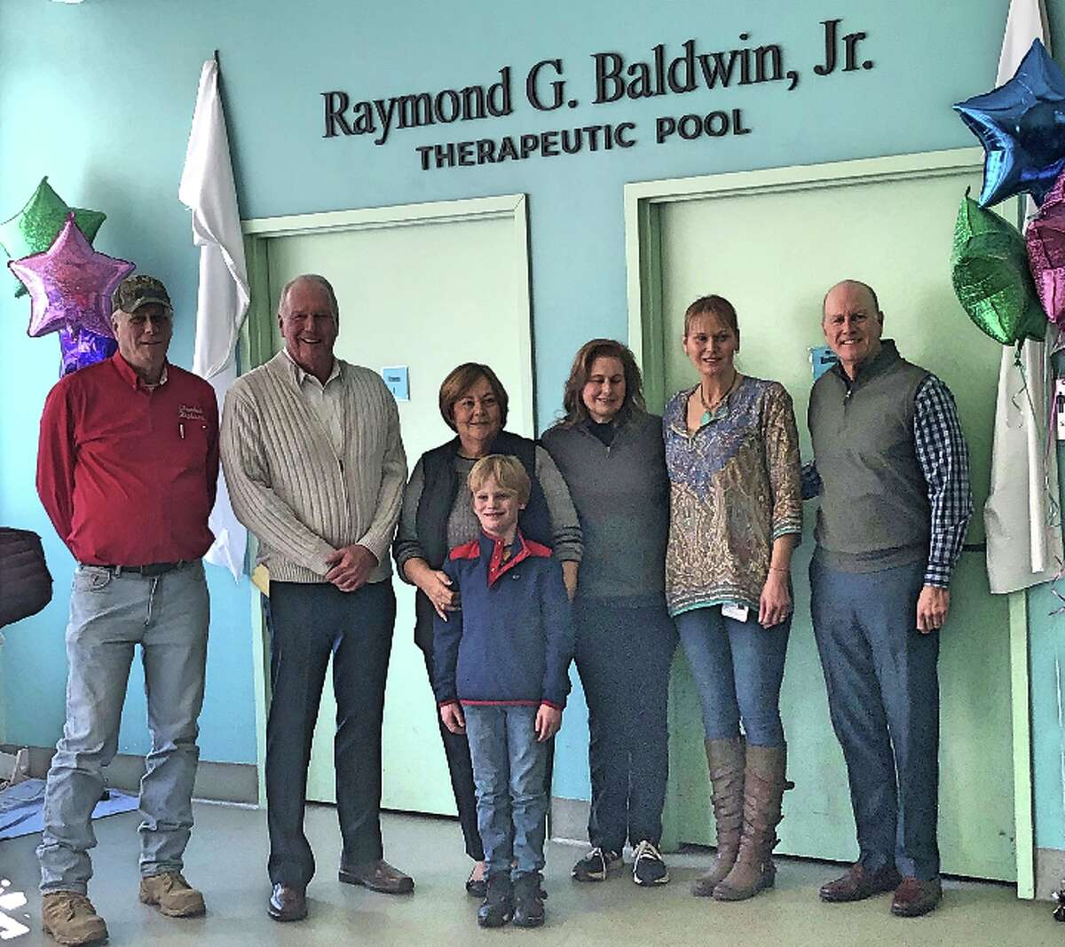 """Former First Selectman Raymond G. Baldwin, second from left, says the rehabilitation work done by the staff of the Feroleto Center in Trumbull is """"like watching a miracle."""""""