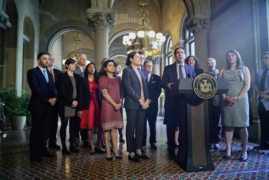 Senator Todd Kaminsky, at podium, the Chair of Environmental Conservation Committee, along with fellow Senators, Assembly members and supporters of climate legislation hold a press conference to discuss their push for legislation on Tuesday, June 4, 2019, in Albany, N.Y.    (Paul Buckowski/Times Union) Photo: Paul Buckowski, Albany Times Union / (Paul Buckowski/Times Union)