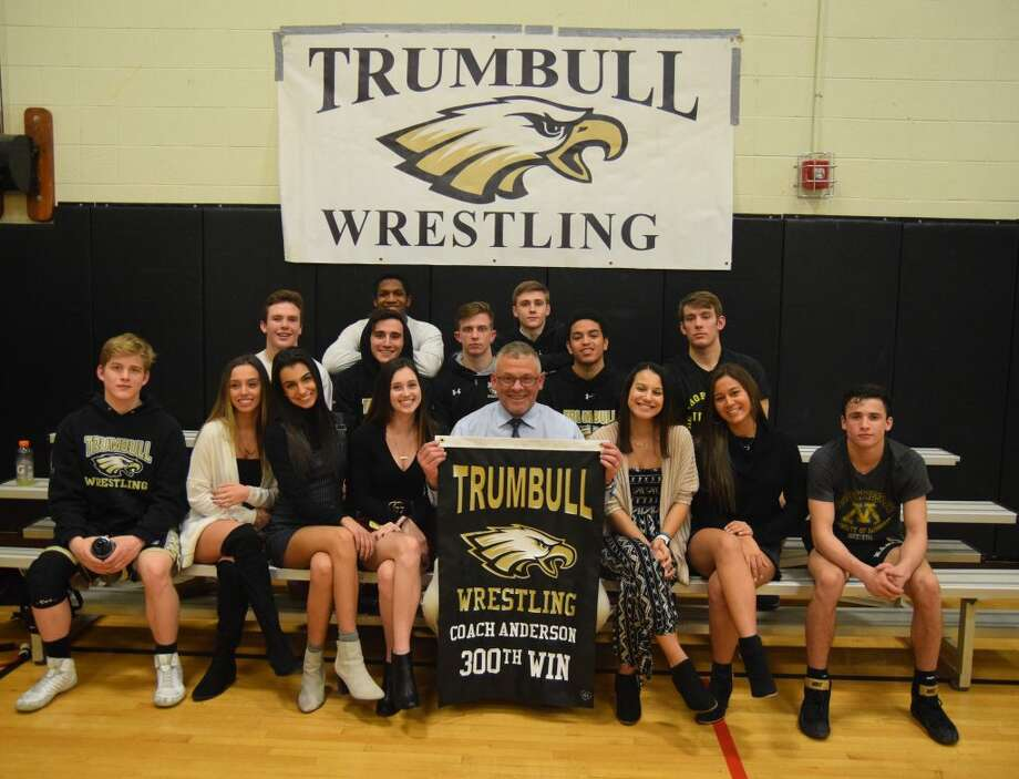Trumbull High head wrestling coach Charlie Anderson, who won his 300th coaching decision, gets together with senior members of the team. Front row: William Holmes, Linda Rakaj, Ellen Rosa, Cassie Gallace, coach Anderson, Bella Siberon, Izzy Robertti and David Castaldo; (second row) Matt Ryan, Wael Pezreh, Jon Kosak, Joe Alicea and Joe Palmieri; (third row) Webster Williams and Travis Longo.Dee Sollenberger / Contributed photo