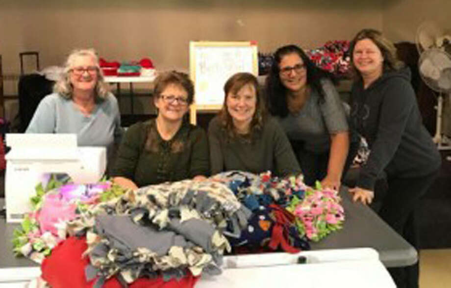 The Monroe/Trumbull chapter of Binky Patrol has joined forces with CT-NOW to make purple shawls for victims of domestic abuse.