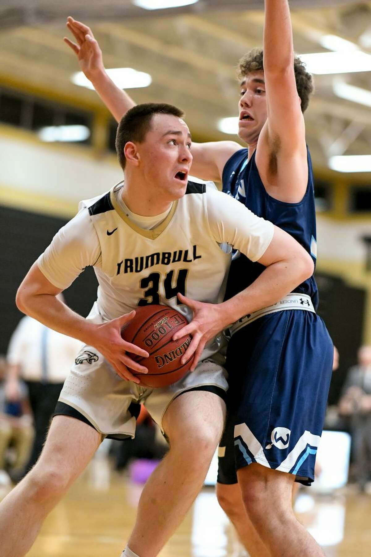 Trumbull's Evan Gutowski gets position on the block.Photo: David G. Whitham / For Hearst Connecticut Media