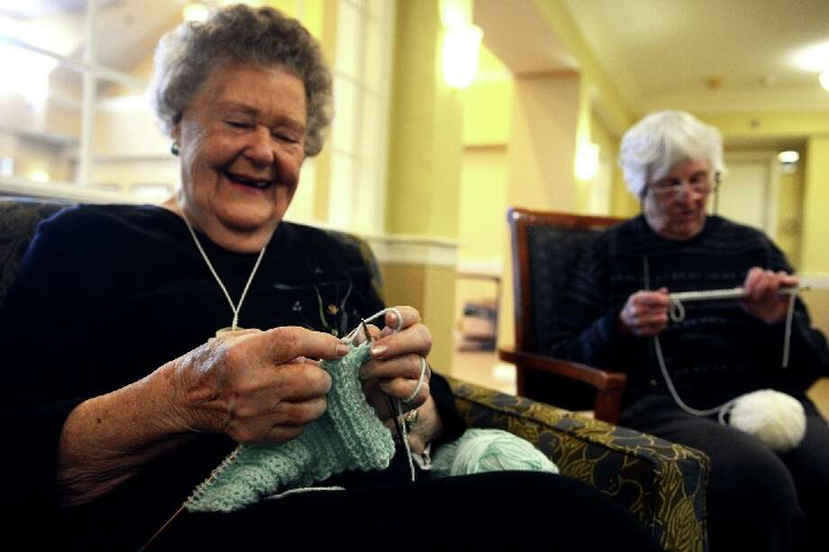 "Birdie Bezursik, left, knits at hat during the ""Little Hats, Big Hearts"" event at Middlebrook Farms, in Trumbull, Conn. Jan. 21, 2019. Residents of the facility gathered together to knit hats for babies born with life threatening congenital heart defects. Their goal is to make 100 hats, over the next month, that will be donated to local hospitals. / Connecticut Post"