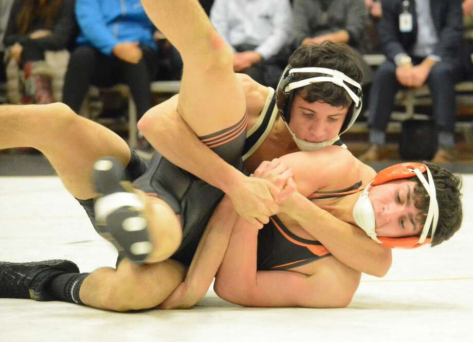 Trumbull's David Castaldo, winning here versus Shelton, scored a key victory in the match with Newtown. — David G. Whitham photo