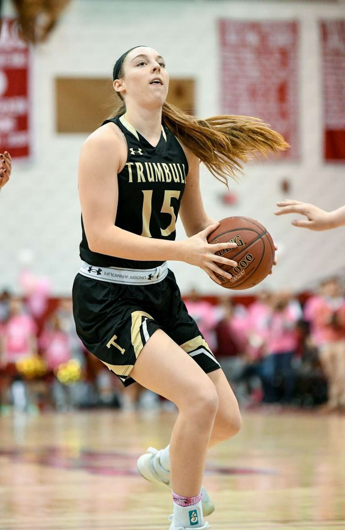 Trumbull's Krystina Schueler was fouled driving to the basket, and made a free throw to give the Eagles a 47-46 win over St. Joseph. - David G. Whitham photos