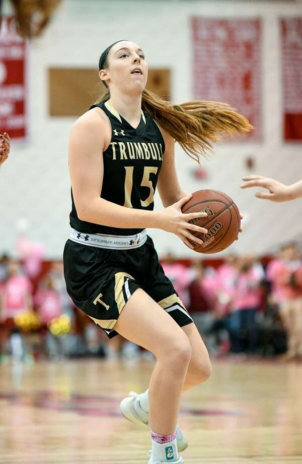 Trumbull's Krystina Schueler was fouled driving to the basket, and made a free throw to give the Eagles a 47-46 win over St. Joseph. — David G. Whitham photos
