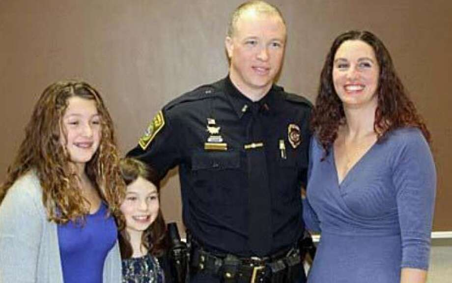 The Trumbull Police Department recently promoted Sgt. Donald Allen to the rank of lieutenant. Attending the ceremony were his parents and family. Allen stands with his wife Heather and daughters Aprile and Ashlie.