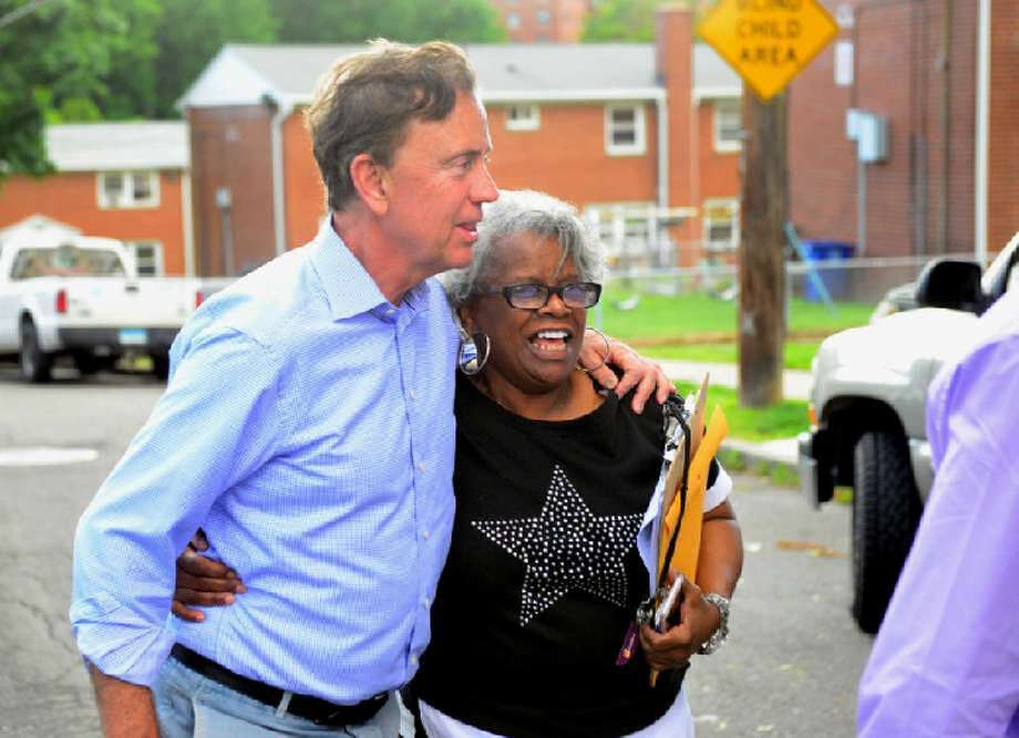 Ned Lamont greets a motorist as he and State Senator Marilyn Moore greet residents at the Second Stoneridge co-op, during a campaign stop at the co-op on Yaremich Drive in Bridgeport, Conn., on Tuesday, June 5, 2018.