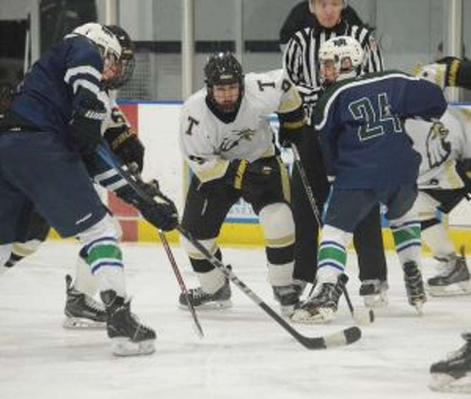 Nick Marinos looks to win the face off. — Andy Hutchison photos