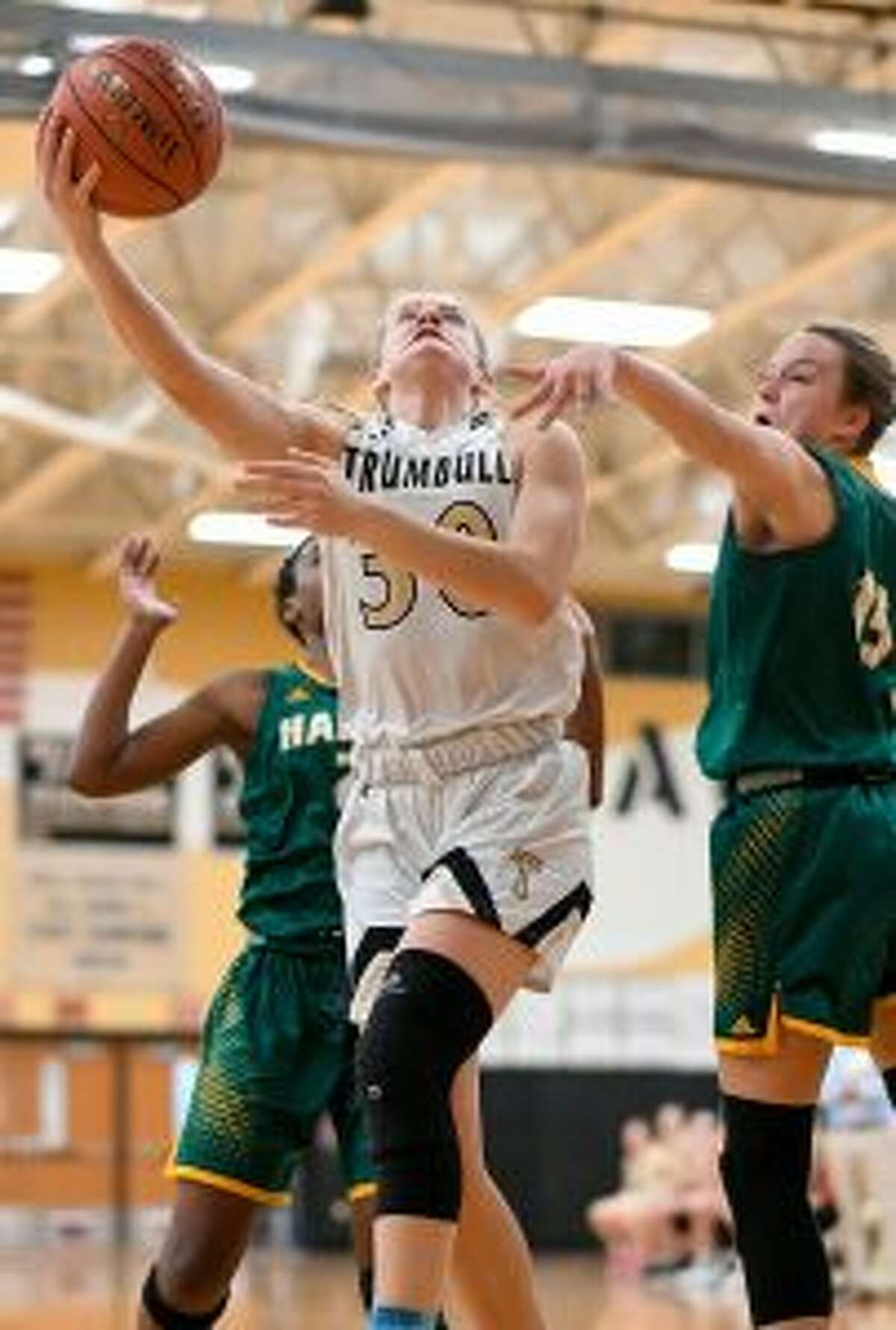 Allie Palmieri gets inside between two defenders for a basket. - David G. Whitham photos