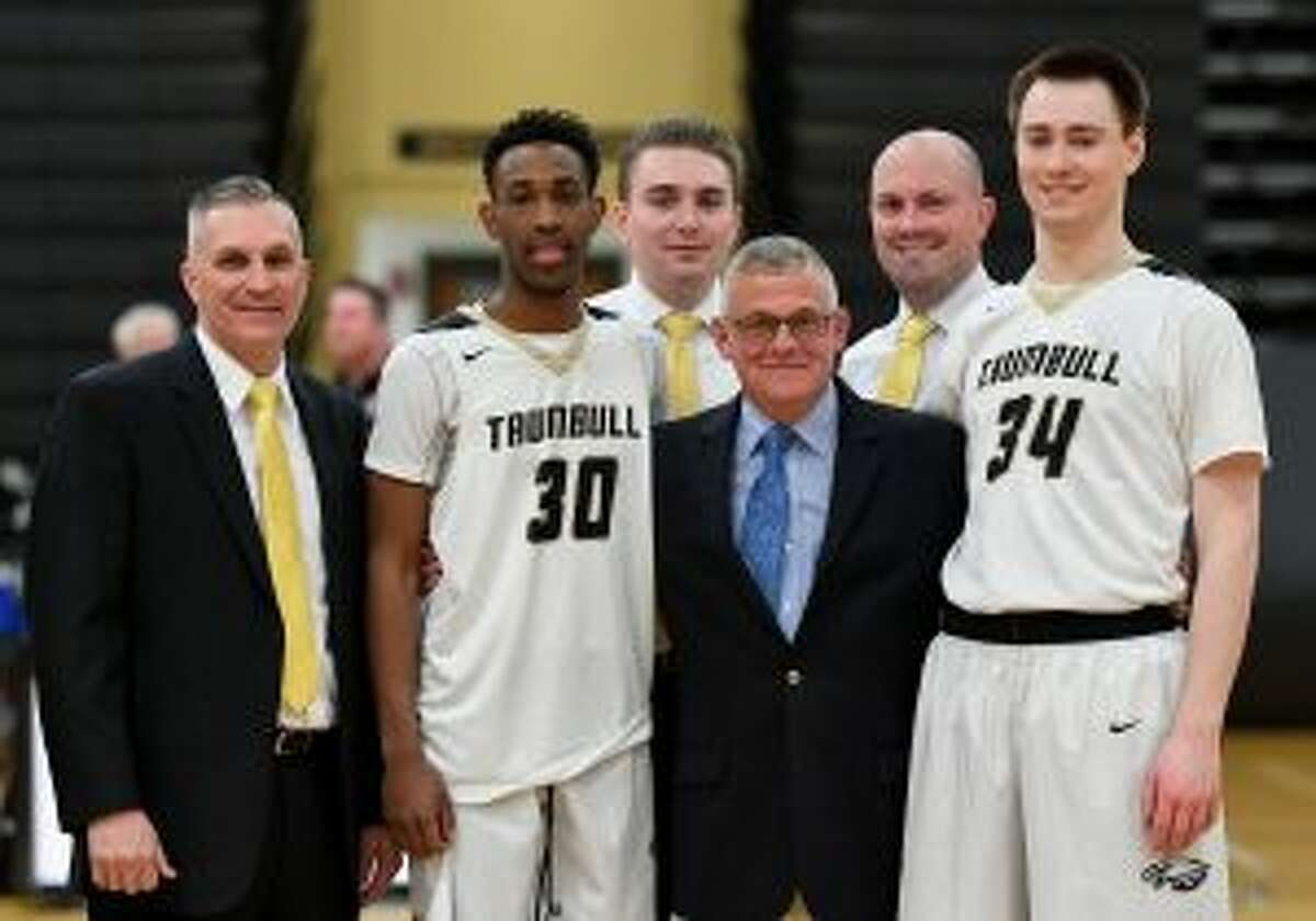 Charlie Anderson, a colonel in the Connecticut National guard, was honored before Trumbull High's boy's basketball game with New Canaan.With Anderson are Trumbull head coach Buddy Bray, co-captain Timmond Williams, assistant coach Cliff Bray, assistant coach Bob Packer and co-captain Evan Gutowski. - David G. Whitham photo