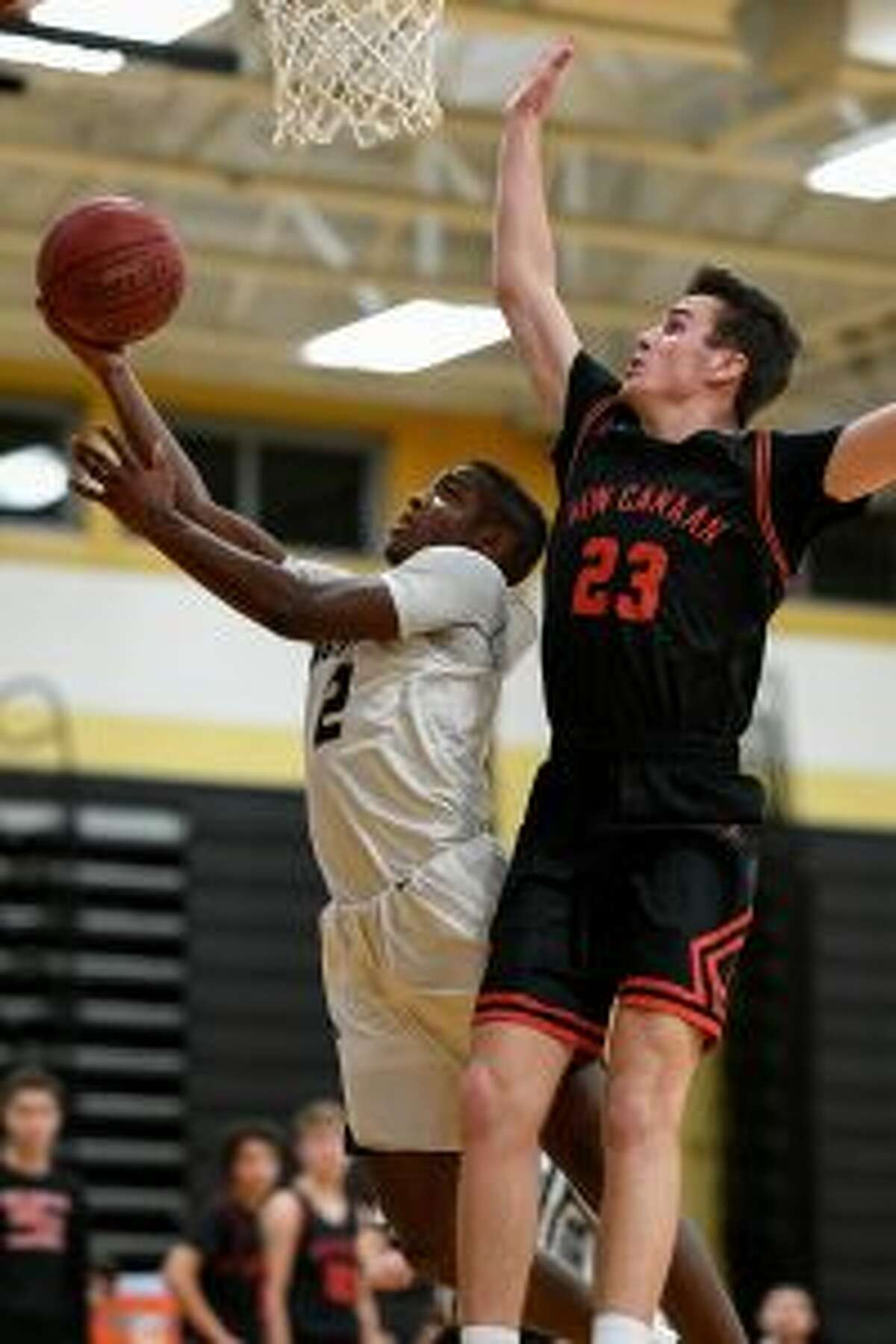 Mileeq Green puts this shot over New Canaan's Jack Richardson.