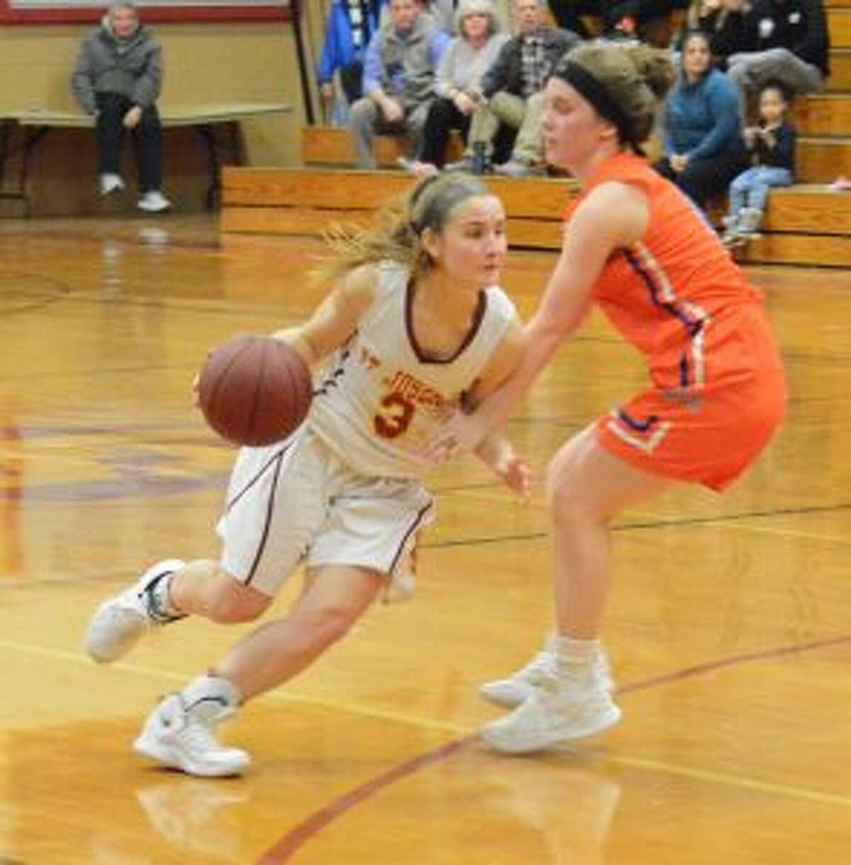 Kathryn Zito drives past a Danbury defender. - Andy Hutchison photo