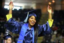 Erika Robinson, of Norwalk, celebrates as she come forward to receiver her diploma Commencement for the Housatonic Community College Class of 2019, held at Webster Bank Arena in Bridgeport, Conn. May 22. 2019.