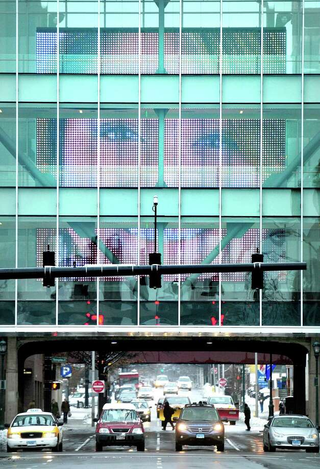 A three story video display alternates a series of videos of faces on the walkway connecting buildings at Gateway Community College in New Haven on 1/16/2013. Photo by Arnold Gold/New Haven Register AG0480E