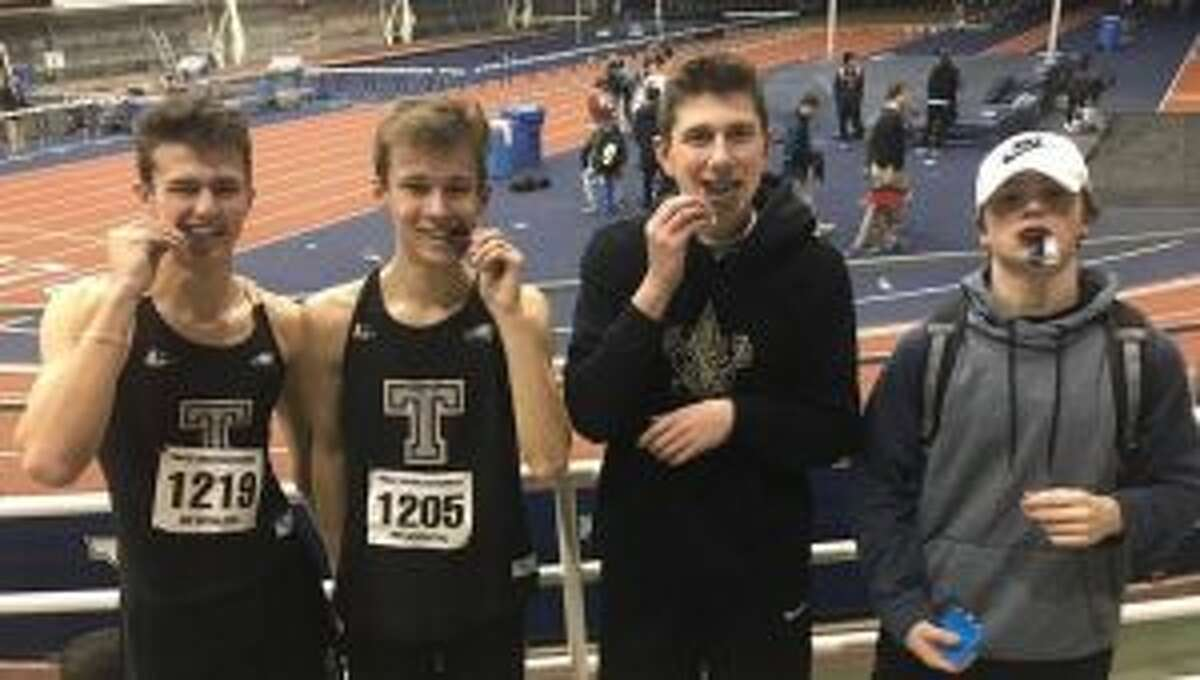Zach Seymour, Evan Seymour, Royal Barsky and Shea Grant with their third place medals earned in the 4x200 relay at Yale.