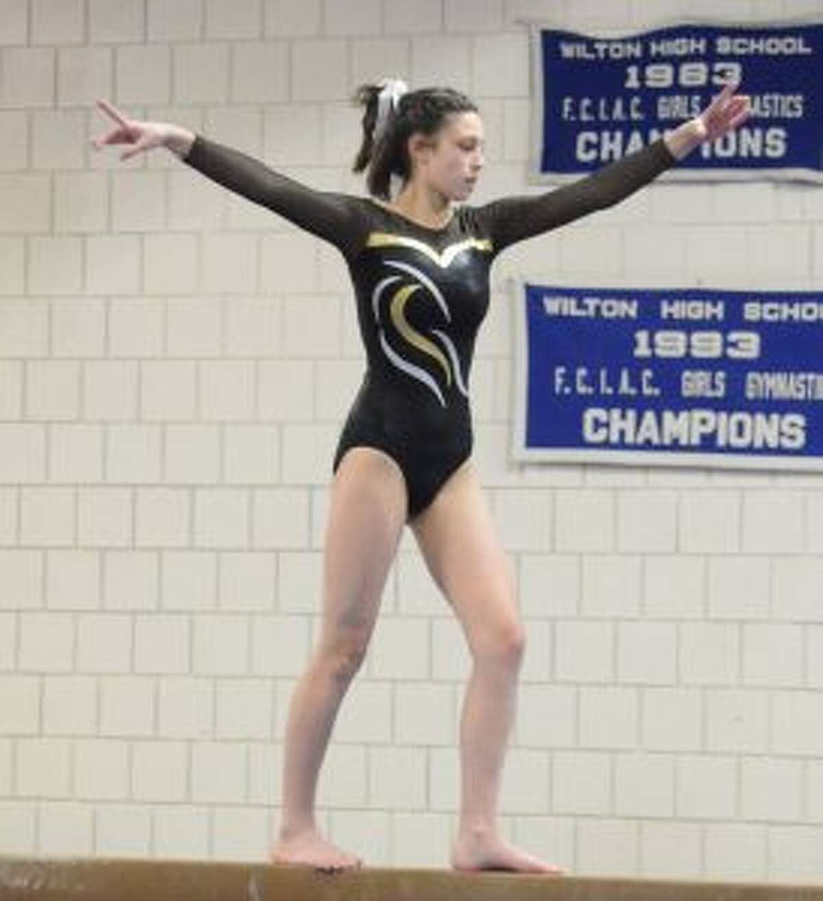 Trumbull's Leah Cody competes on the balance beam.
