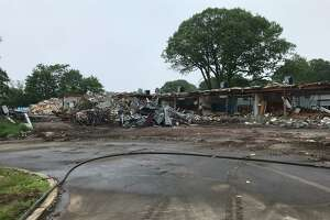 Demolition of the old New Lebanon School continues as the last day of school approaches.