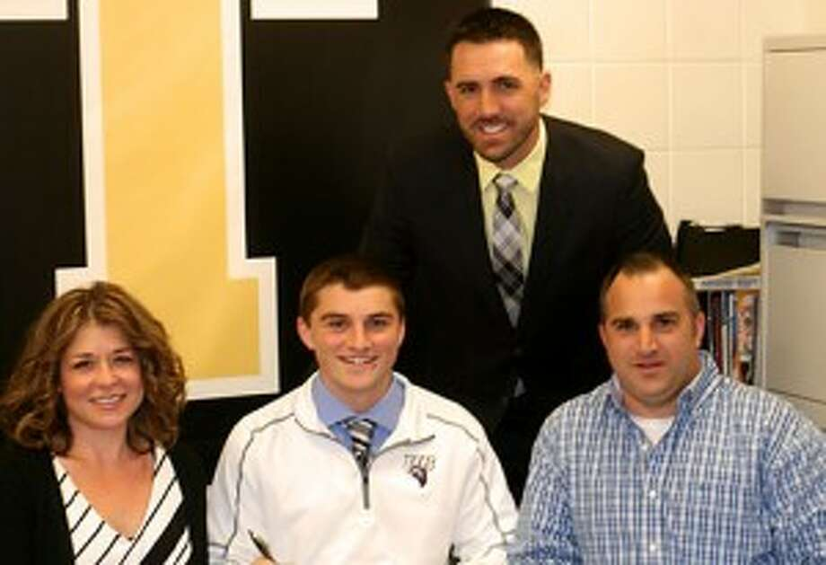 Alex Rauso is joined by his mom Cathy and dad Alex and Legion coach Brett Conner when the Trumbull High catcher signed his letter to attend the University of Bridgeport. Missing from photo is Trumbull High coach Phil Pacelli. — Bill Bloxsom photo