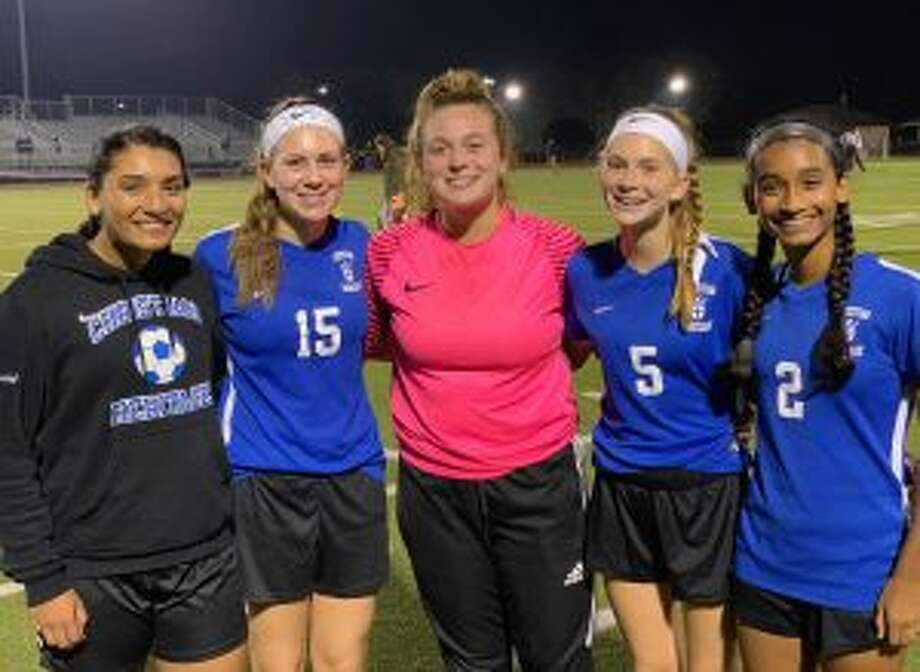 CHS players Ranita Muriel, Mia Angelini, Ainiah Perretta, Alex Angelini and Natania Muriel get to together on Senior Day.