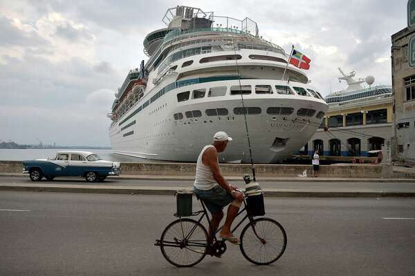 A Royal Caribbean cruise is seen docked at Havana's port on May 6, 2019. - The activation of Chapter III of the Helms-Burton Act that seeks to intensify the US blockade against Cuba will particularly affect the self-employed sector by limiting the trips of Americans to the island. In April, US President Donald Trump ramped up pressure on Cuba with new restrictions on US travel and remittances and a green light to lawsuits over seized property as he vowed to rid Latin America of leftists. (Photo by Yamil LAGE / AFP) (Photo credit should read YAMIL LAGE/AFP/Getty Images)