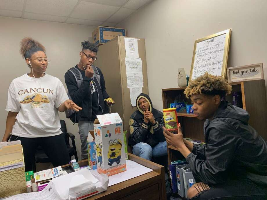 In Conroe ISD, there are 10 schools that have a Communities in Schools youth service coordinator to act as dropout prevention mentors. Here, Conroe High students in the program hang out in a Communities in Schools office. Photo: Submitted Photo / Submitted Photo