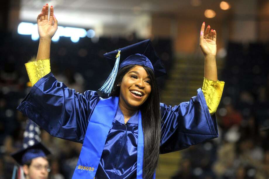 Erika Robinson, of Norwalk, celebrates as she come forward to receiver her diploma Commencement for the Housatonic Community College Class of 2019, held at Webster Bank Arena in Bridgeport, Conn. May 22. 2019. Photo: Ned Gerard / Hearst Connecticut Media / Connecticut Post