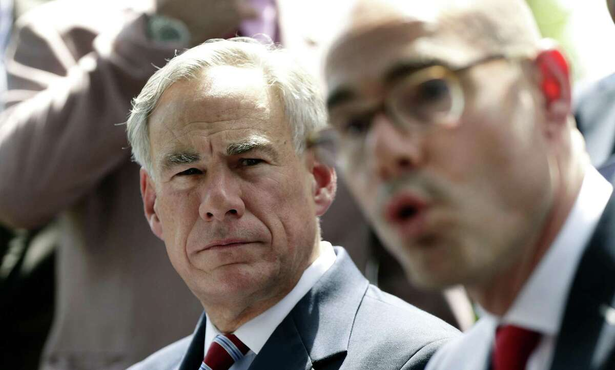 Texas Governor Greg Abbott, left, listens as Speaker of the House Dennis Bonnen, right, answers a question during a joint news conference to discuss teacher pay and school finance at the Texas Governor's Mansion in Austin, Texas, Thursday, May 23, 2019, in Austin. Texas Gov. Greg Abbott says $1.6 billion in teacher raises are coming in a deal driven by classroom unrest and Republicans who sharply changed course on public education ahead of 2020. (AP Photo/Eric Gay)