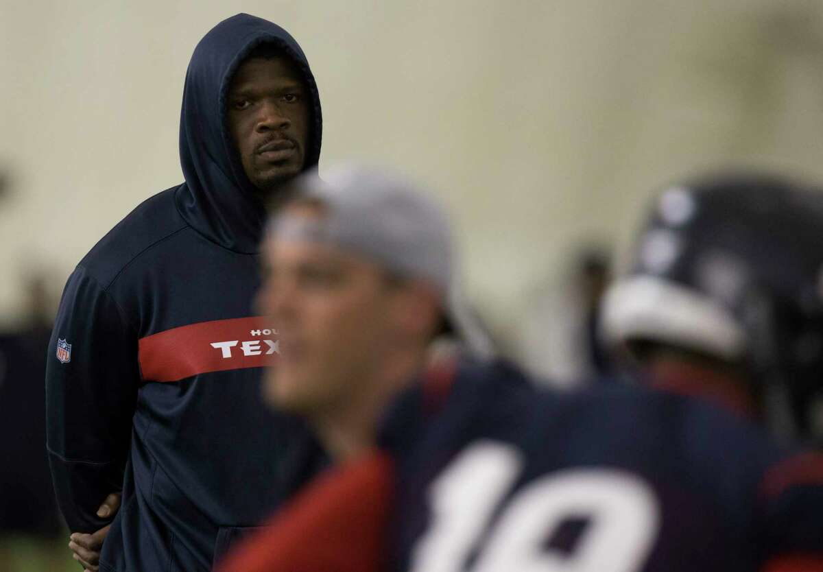 Houston Texans Special Advisor to the Head Coach and General Manager Andre Johnson watches players doing a drill during an OTA session at the Houston Methodist Training Center on Tuesday, June 4, 2019, in Houston.