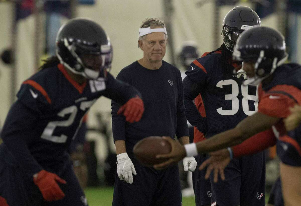 Houston Texans Quarterbacks coach Carl Smith watches players doing a drill during an OTA session at the Houston Methodist Training Center on Tuesday, June 4, 2019, in Houston.