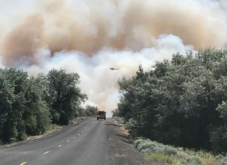 The 243 Fire as seen looking east along Lower Crab Creek Road Tuesday. Photo: Courtesy Grant County Sheriff