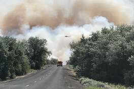 The 243 Fire as seen looking east along Lower Crab Creek Road Tuesday.