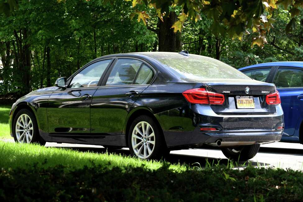 The BMW sedan belonging to Allison Mack, a TV actress who had devoted herself to NXIVM and its leader, is parked in the Knox Woods development where multiple homes associated with NXIVM members are located on Tuesday, June 4, 2019, in Halfmoon, N.Y. (Will Waldron/Times Union)