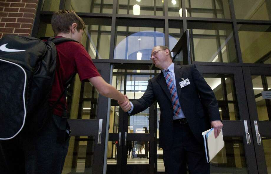 Grand Oaks High School Principal Chris Povich greets students as the new Conroe ISD high school opens its doors for the first time on Wednesday, Aug. 15, 2018, in Spring. Photo: Jason Fochtman, Staff Photographer / Staff Photographer / © 2018 Houston Chronicle