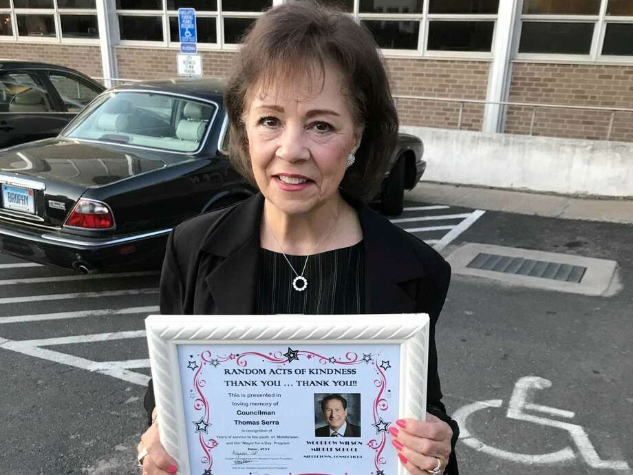 Maryann Serra with a plaque honoring her late husband. The Common Council adopted a resolution honoring the now late Common Council Majority Leader Thomas J. Serra for his many years of service to the city of Middletown. Photo: Jeff Mill / Hearst Connecticut Media