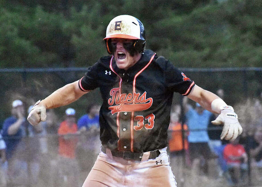 Edwardsville first baseman Drake Westcott celebrates after scoring the go-ahead run in the seventh inning against Marist on Monday in Springfield.