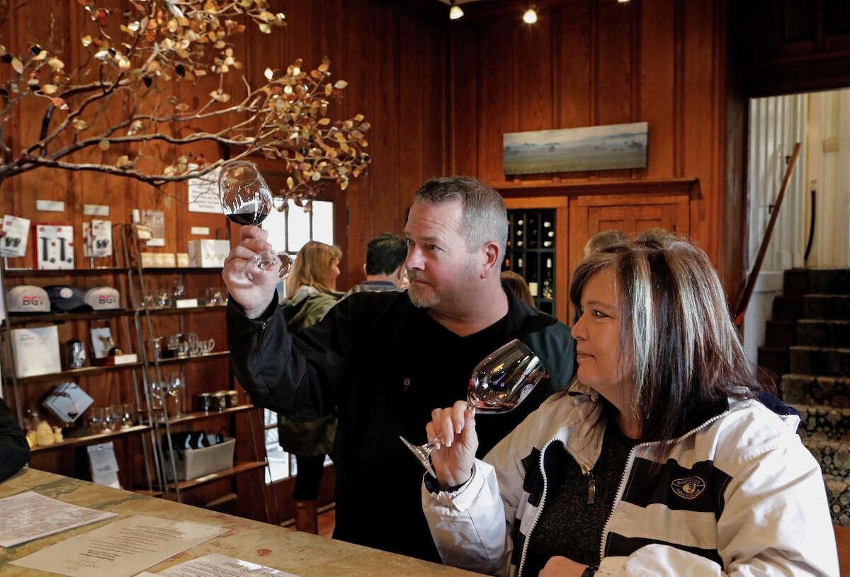 Greg Trivette and Melissa Brunetti sample the wines at the Bella Grace tasting room along Main St. in Sutter Creek, Ca., on Sat. Feb. 16, 2019.