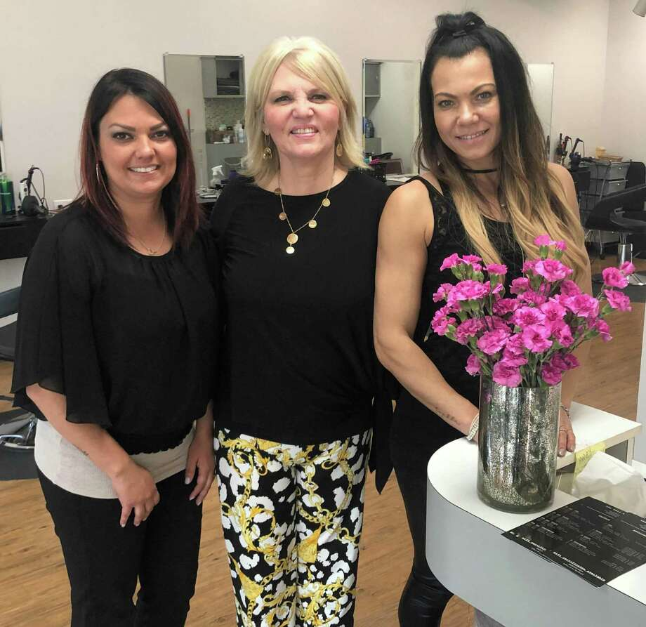 Spectrum/The Nota family of New Milford recently celebrated the grand re-opening of their business, formerly known as Creative Haircutters. The business is now The Hair Salon. A ribbon-cutting ceremony and celebration was held May 23, 2019. Above are owner Rachel Nota, center, with daughter and stylists Nicky Nota Burns, left, and Bernadette Nota-Conte. Photo: Deborah Rose / Hearst Connecticut Media / The News-Times  / Spectrum