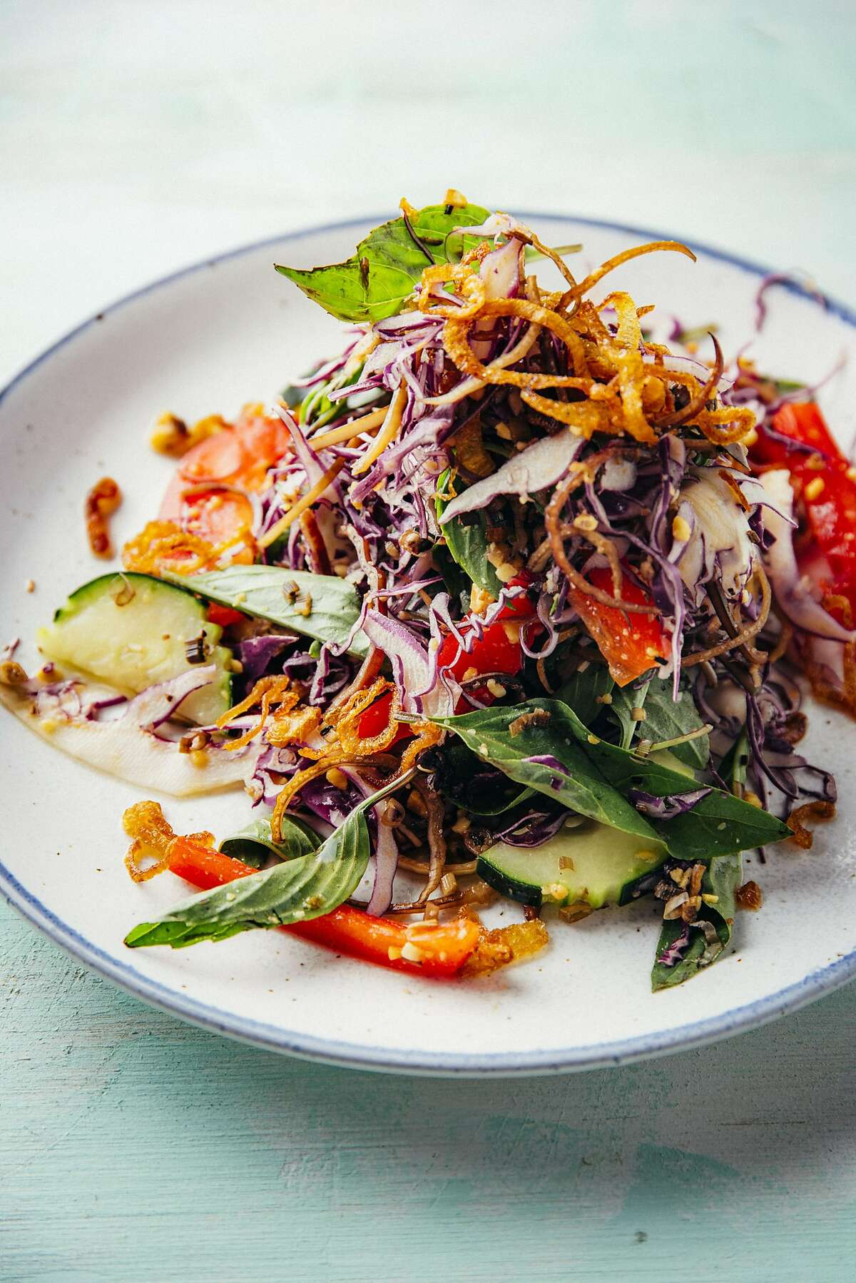 """Nite Yun serves neorm sach moan (Cambodian chicken salad) in her hit Oakland restaurant Nyum Bai. The recipe is featured in the """"We Are La Cocina"""" cookbook."""